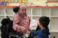 Nick Shares book with student, Porfirio