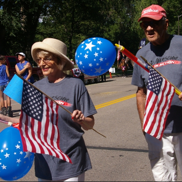 Senora Urban, with husband, Leonard, marches with on the 4th